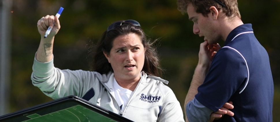 Smith College coaches discuss strategy on the field