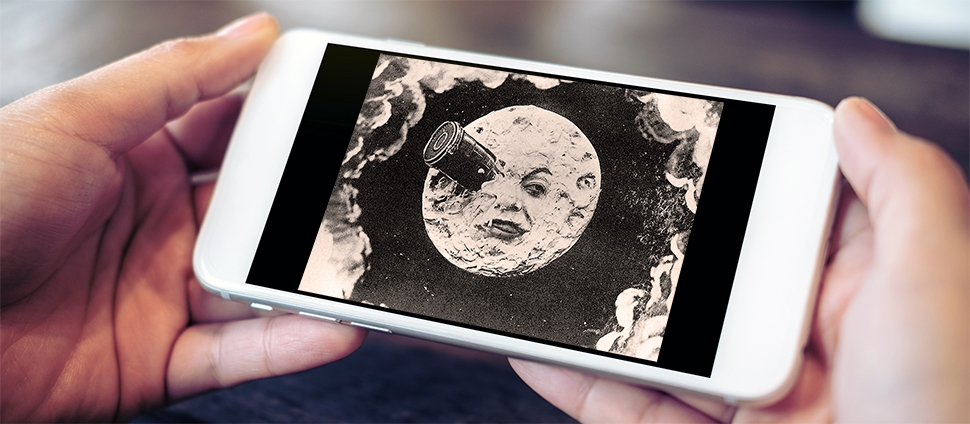 Still from the 1902 film A Trip to the Moon on a cell phone screen