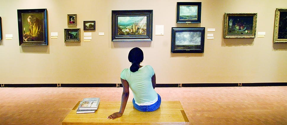 Student looking at paintings in the Smith College Museum of Art