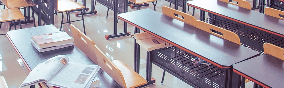 Classroom Desks with open Textbooks