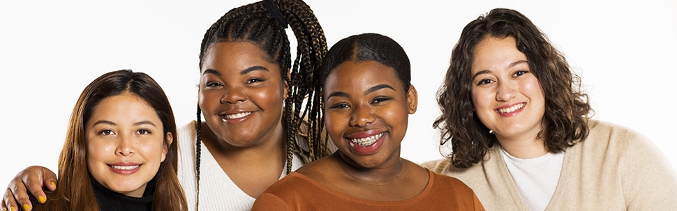 Portrait of four students on a white background