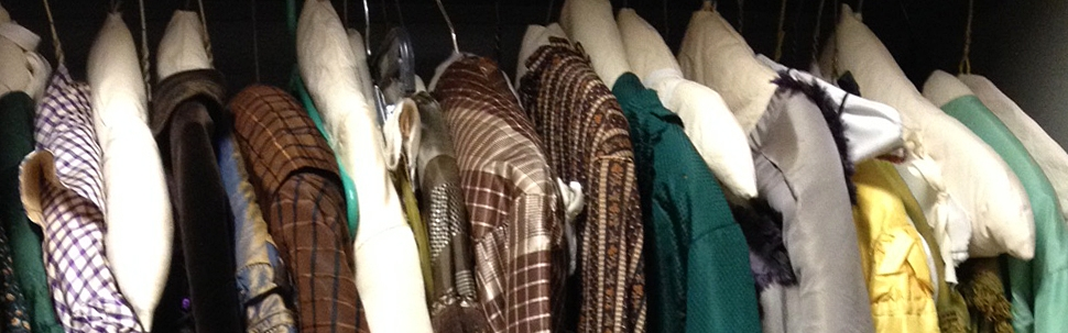 Row of clothes hanging in a closet