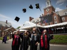 2019 graduates throwing hats