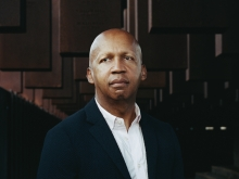 Bryan Stevenson in front of the National Memorial for Peace and Justice