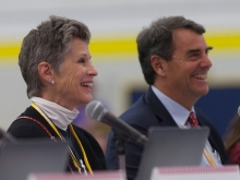 Melisa Parker and Tim Draper smiling during a presentation
