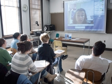 Student in a classroom participating in a web conference