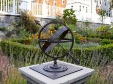 metal globe and sundial