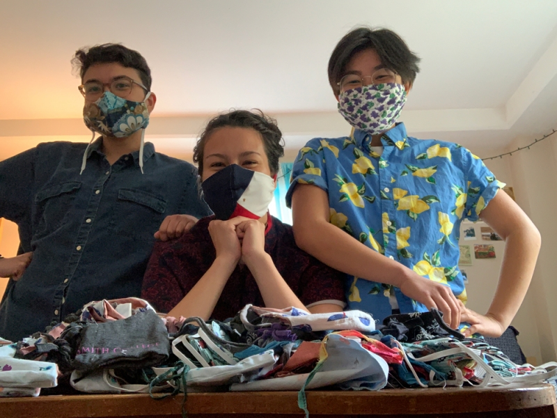 Amelia Windorski and friends modeling face masks they had sewn