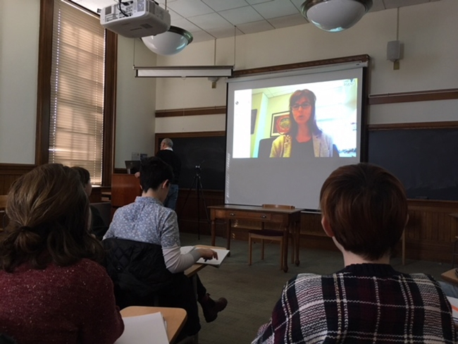 Students in a Smith government class conducting a Skype interview with New York Times reporter Coral Davenport '98.