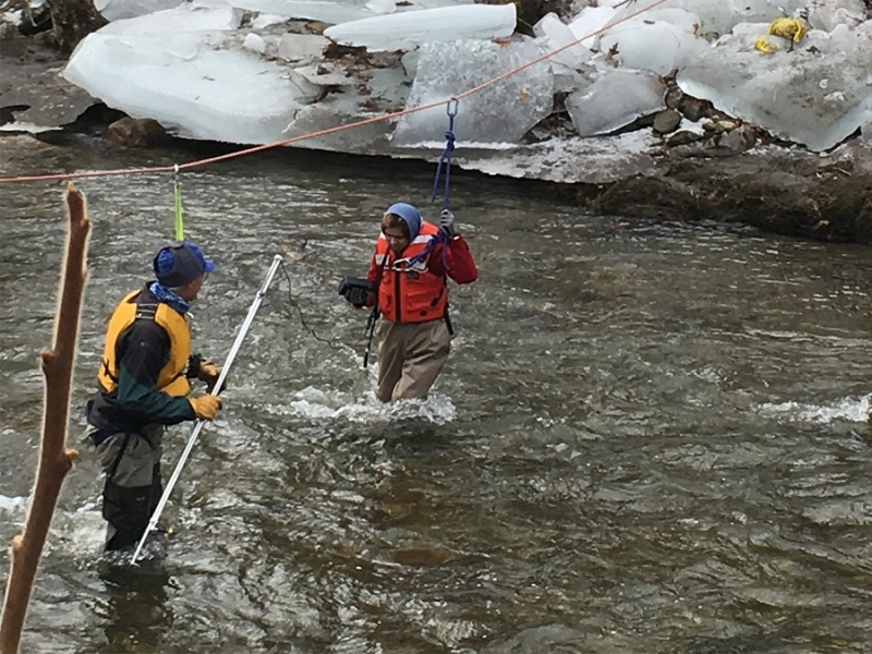 Fereshta Noori '18 surveying the Mill River with safety line help from Paul Wetzel, Smith lecturer in environmental science and policy.