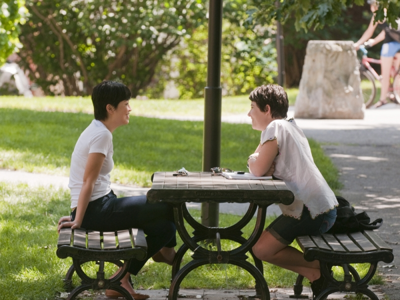 two people at a picnic table