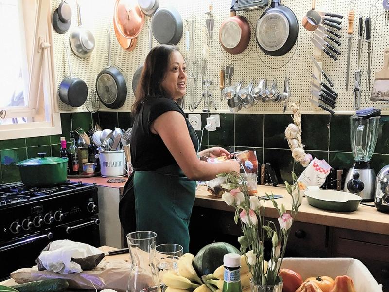 Shaila Manyam 94 cooking in Julia Child's kitchen