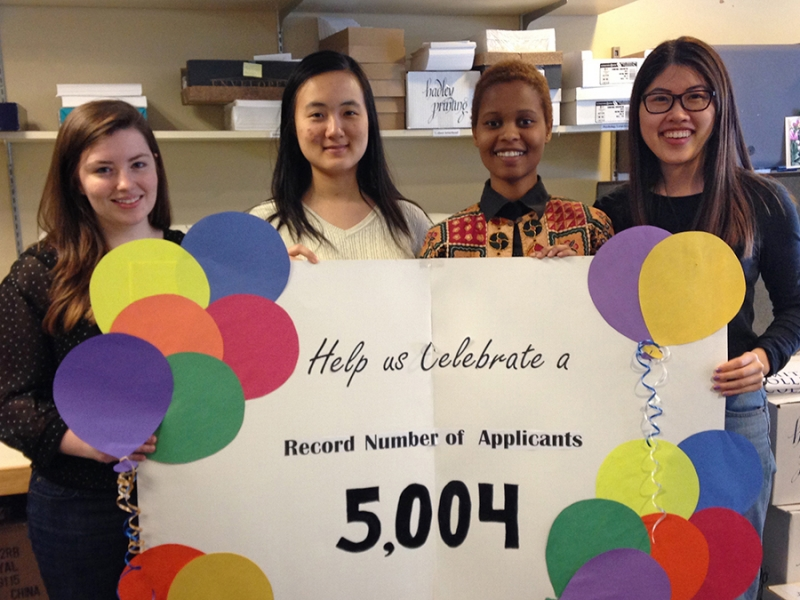 Student workers in the admissions office help celebrate the 2015 record breaking admission numbers