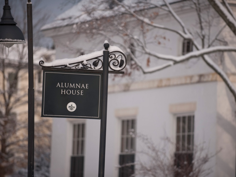 alumnae house sign with snow