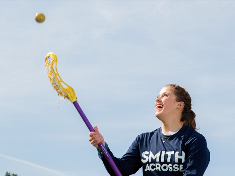 Jessica Lindquist tossing a ball in the air