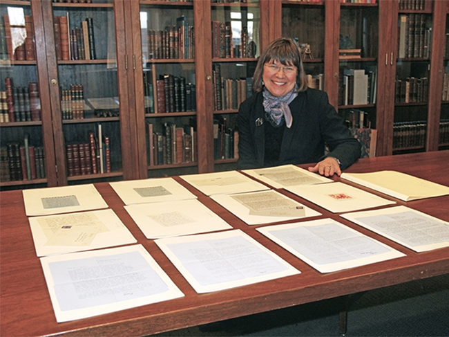 Karen Kukil, associate curator for special collections at Smith, surveys 12 letters from Sylvia Plath '55 that were recently donated to the college. Photo by Isabella Casini '17.