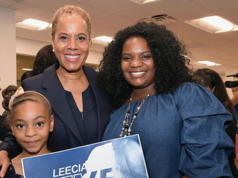 Leecia Eve with two supporters