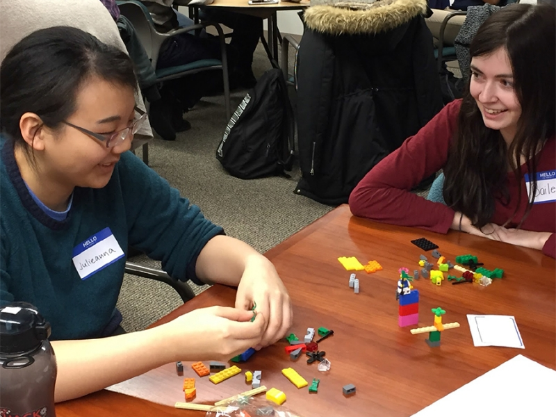 Julieanna Niu '16 (left) and Bailey Vaillancourt '16 play with Legos during a recent workshop for this year's Smith engineering Design Clinic capstone course.