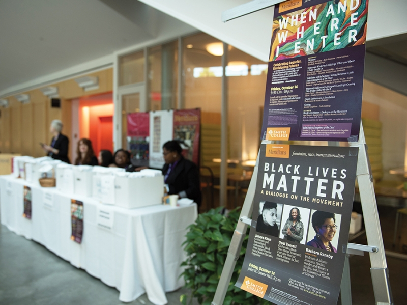Conference registration table in the Campus Center with posters for the Meridians event