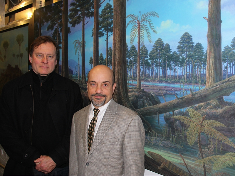 Mural artist Robert Evans (left) and Michael Marcotrigiano in front of the mural