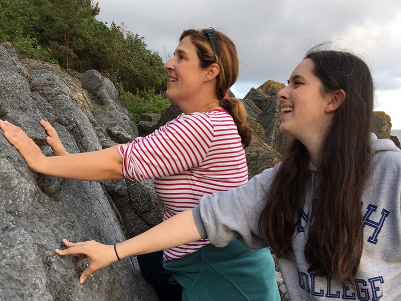 Associate Professor of Geosciences Sara Pruss and Emma Roth '17 exploring a rock face in Norway.