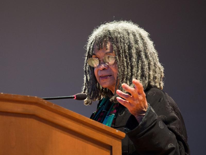 Sonia Sanchez speaking at a podium