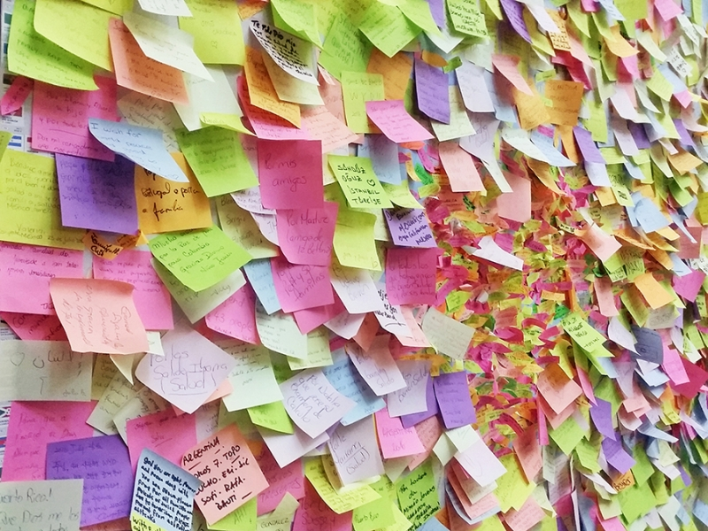 Collage of many color post-it notes