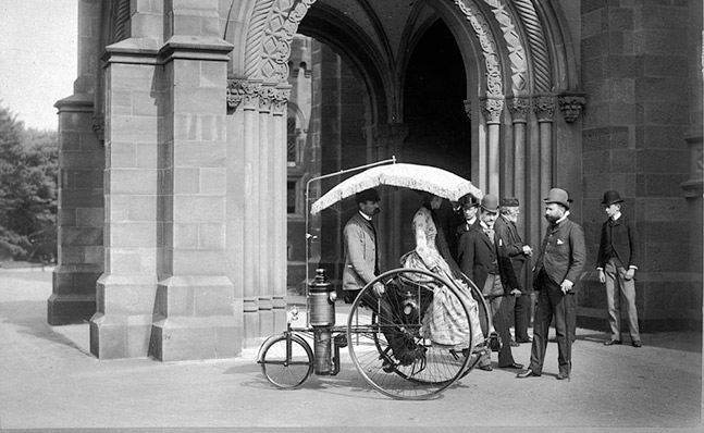 Steam Powered Tricycle parked outside the Smithsonian in 1888