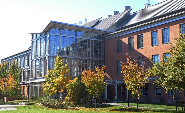Exterior shot of Ford Hall in the fall