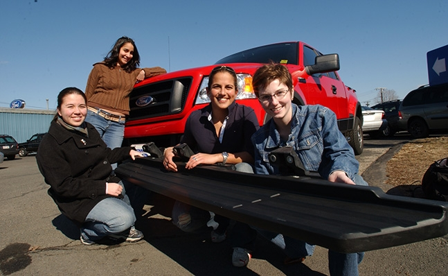Students Display Running Board for Ford Truck