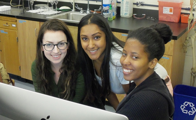 Three neuroscience students in the lab