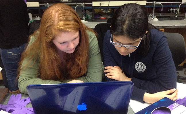 Two students reviewing data