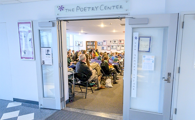Group of people attending a Poetry Center event