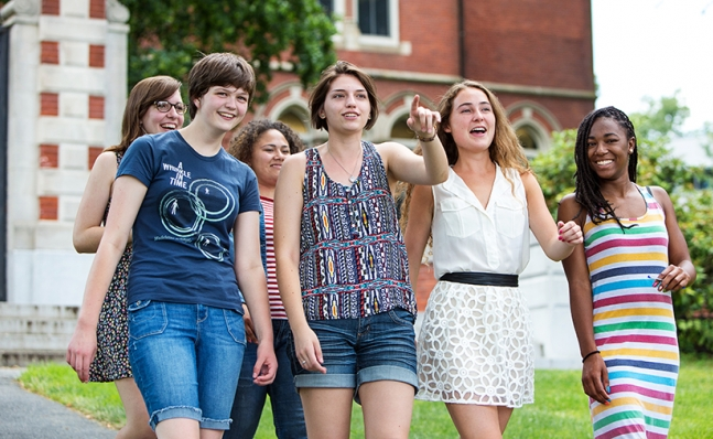 A group of young women walk together on Smith campus, during precollege summer programs