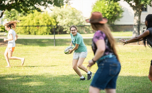 Students playing rugby on campus