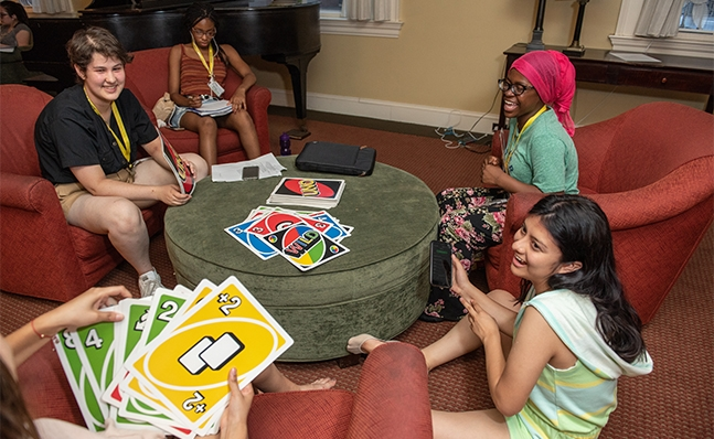 Group of students playing Uno card game