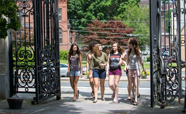 Students walking through gates on campus