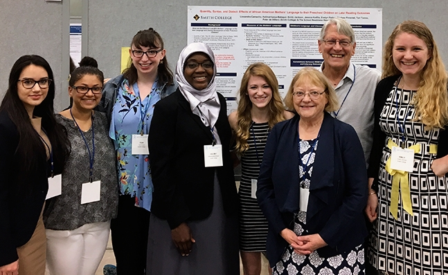A group of students posing with one of their posters at the Society for Research in Child Development (SRCD) Convention in Austin TX in April 2017.