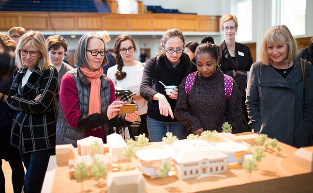 Students viewing the model of the new Neilson Library