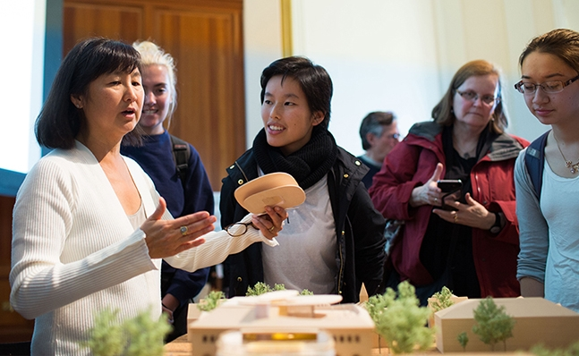 Maya Lin and students viewing the model of the new Neilson Library