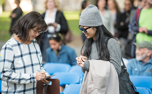 Student gets an autograph from Maya Lin