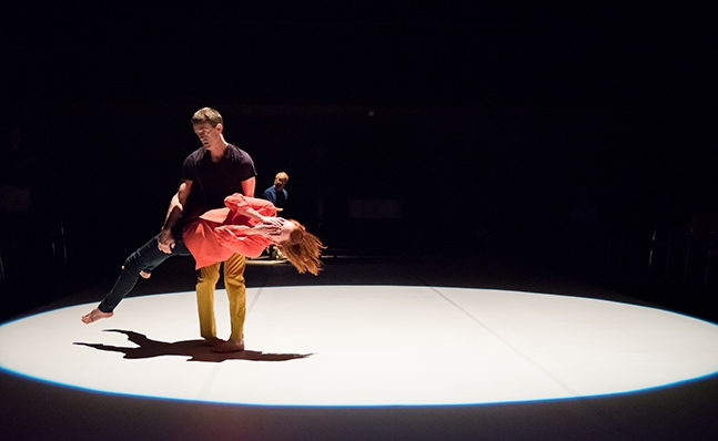 Two dancers in a spotlight