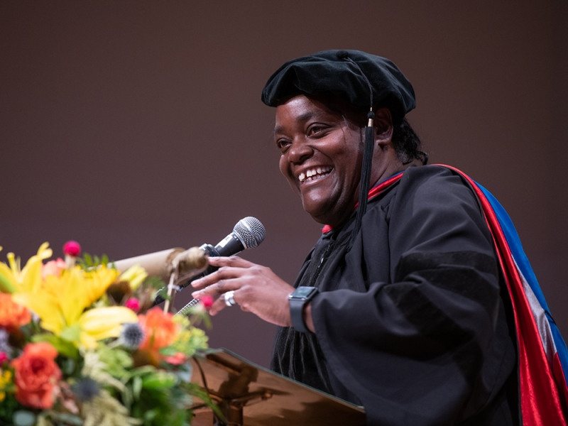 Dottie Morris at the podium at the School for Social Work commencement ceremony