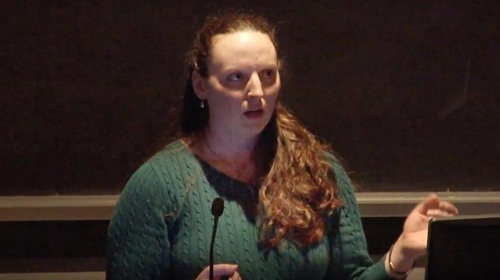 Lauren Metskas talking at the podium