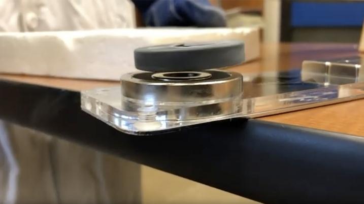 Video still of a superconductor levitating