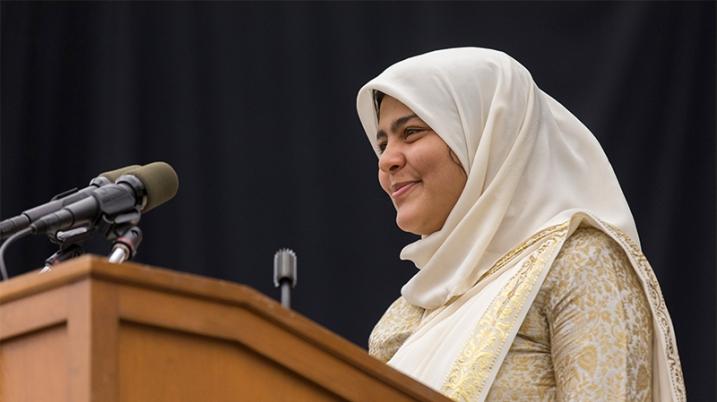 Zainab Rizvi at the podium
